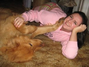 In my pink Maryland hoodie... and being beat up by my dog