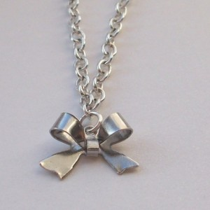Mini bow necklace by CosmicCreatures, $8